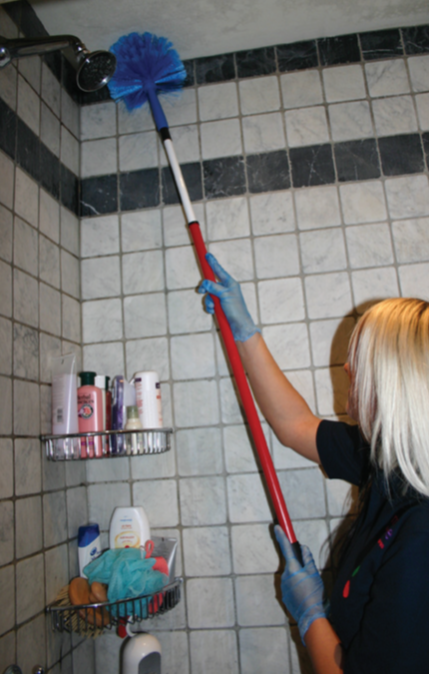 lady cleaning bathroom