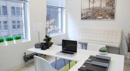 home office, white in colour with a L shaped desj and white chair