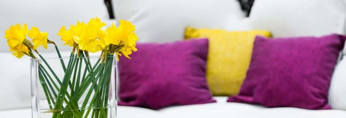 The Benefits Of Spring Cleaning Home With Cushions And Flowers