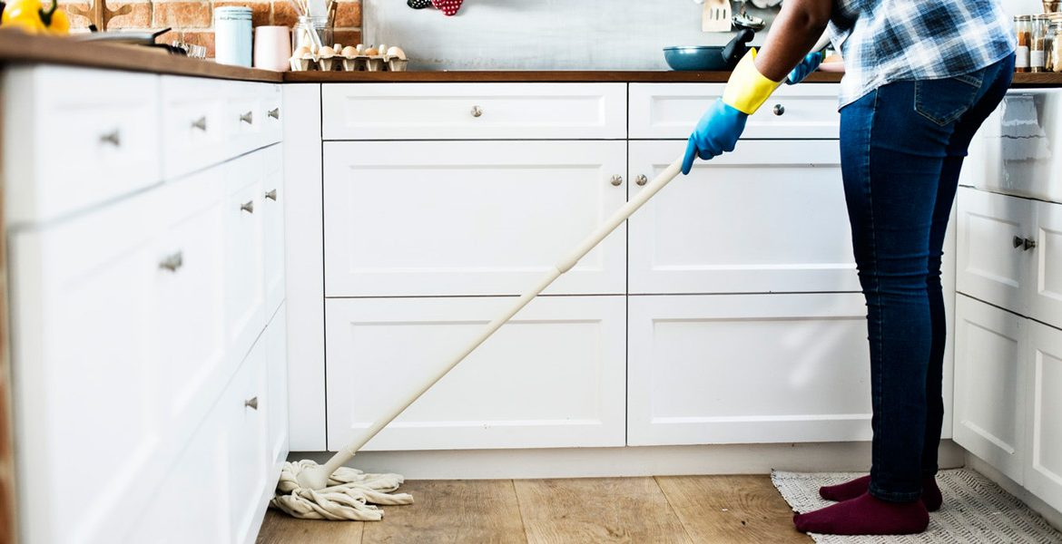 Women Mopping The Floor